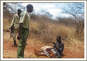 arrested poacher with snares at mangerete