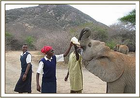 Kasaala student enjoy watching the DSWT Orphans