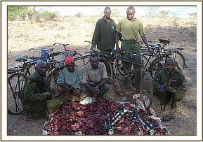 Arrested poachers,confiscated bicycles & bushmeat