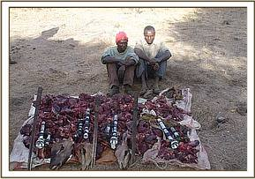 Arrested poachers with confiscated bushmeat