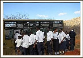 Kasaala students board the bus at kiasa hill