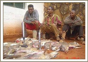 The three arrested poachers with the dead Dikdik