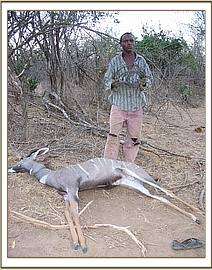 Poacher with a Kudu he got from one of his snares