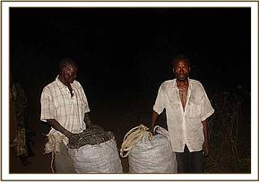 2 charcoal burners with bags of charcoal