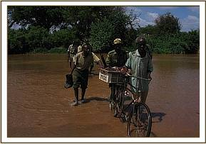 Crossing the river with the arrested poacher