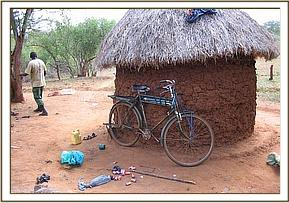 The poachers hut with his tools & bicyle outside