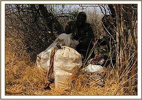 Team examining poachers' luggage.