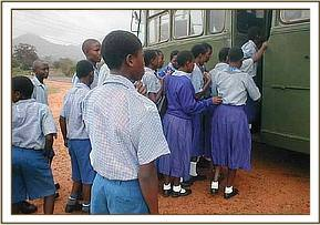 The students boarding the bus for the field trip