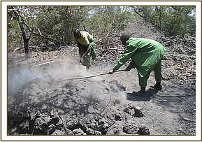 Team members destroying illegal charcoal kilns