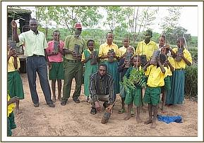 Students from Ngiluni primary with tree seedlings