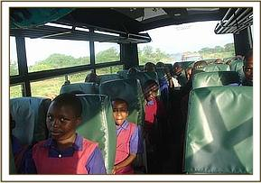 Musiini primary students on the bus