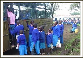 Nguluni primary pupils boarding the bus