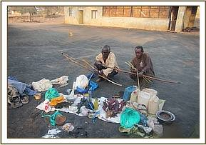 Arrested poachers with their belongings