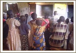 Msorongo community members watching a video