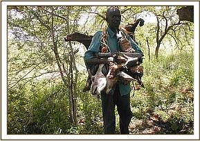 The poacher with the butchered lesser kudus