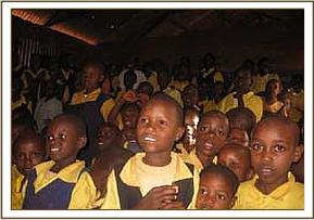 Students at Kikwasuni watching a wildlife film