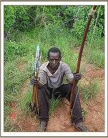 Arrested poacher with his bow & poisoned arrows