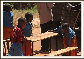 Off loading desks at Kakindu School