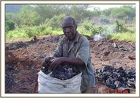 Charcoal burner at his kiln