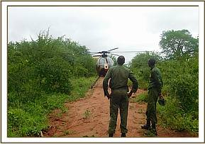 TEAM MEMBERS WITH WITH AERIAL RECCE CHOPPER