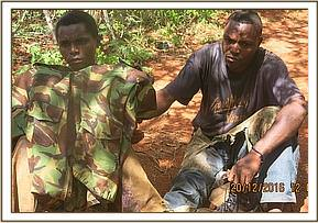 Arrested poachers at their camp