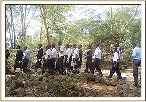 Chala students walking around Mzima Springs