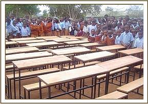 Students surround the donated desks