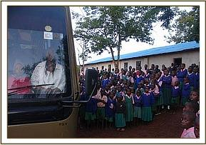 Kithasyo primary school pupils see the bus off