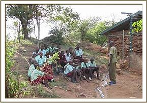 Ngwate pupils receive a lecture from a keeper