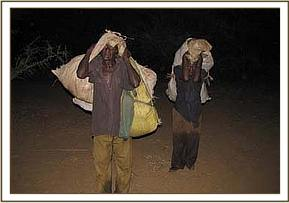 Two arrested poachers carrying bushmeat