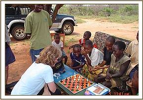 Sue Gilbert teaches the children to play chess