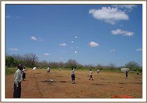 Kids from the Mtito area learn to fly kites