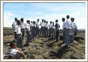 Students at Shetani lava in Tsavo West