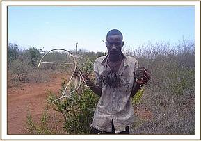 Arrested poacher with his snare