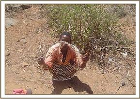 The arrested poacher showing his tools