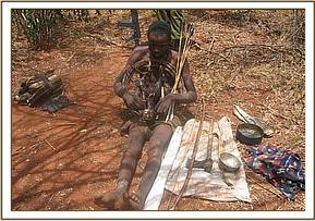 Arrested poacher displays snares, bows,& arrow