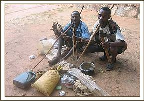 The two arrested poachers, their tools and wares