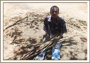 One of the arrested poachers with bows and arrows