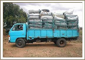 Charcoal in a lorry being taken to market