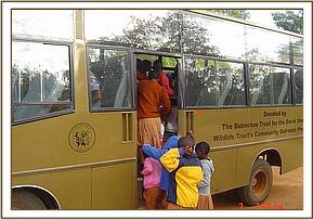Students from Msorongo primary board the bus