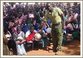Presenting sports equipment to Kithasyo primary