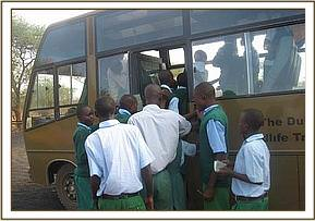 Miangeni primary students boarding the bus