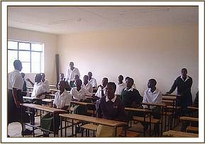 Students sitting at donated desks in classroom