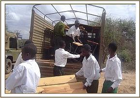Offloading the Donated desks from the lorry