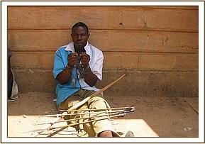 Arrested poacher with bow and poisonous arrows