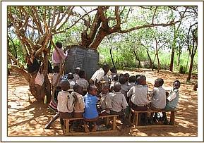 Kavete primary pupils learning under trees