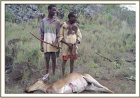 Poachers with the lesser kudu that they killed