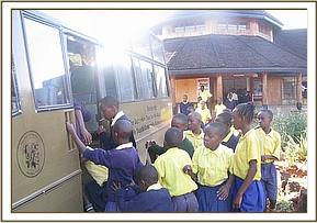 Kikwasuni pupils boarding the Trust bus
