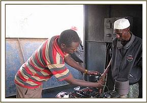 Mechanic doing repair work of Kone water pump