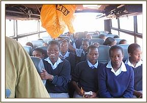Muasaa secondary on the bus during the field trip